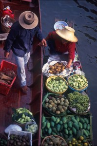 Lady in Boat with vegetables